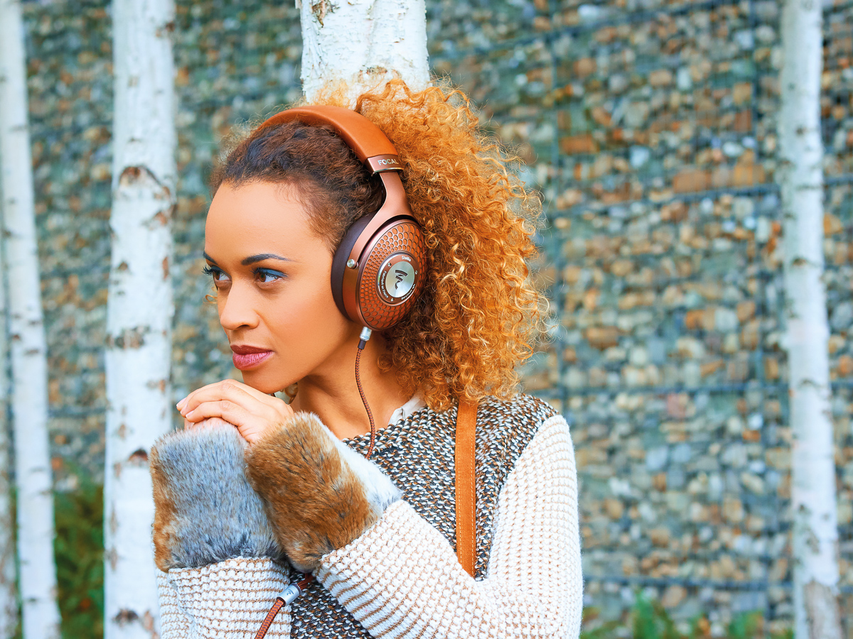 woman wearing Focal Stellia headphones